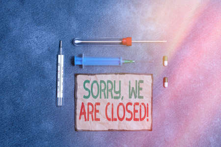 Text sign showing Sorry, We Are Closed. Business photo text apologize for shutting off business for specific time Set of medical equipment with notepad for professional health condition assessment