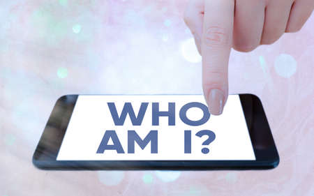 Text sign showing Who Am I Question. Business photo showcasing asking about selfidentity or an individualal purpose in life Modern gadgets with white display screen under colorful bokeh background