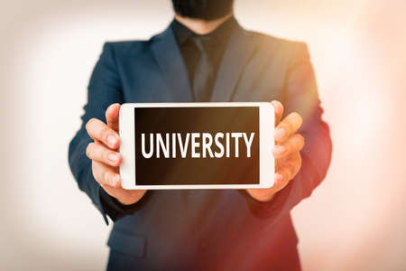 Text sign showing University. Business photo showcasing an educational institution designed to teach and investigate Model displaying black screen modern smartphone mock-up for personal interest