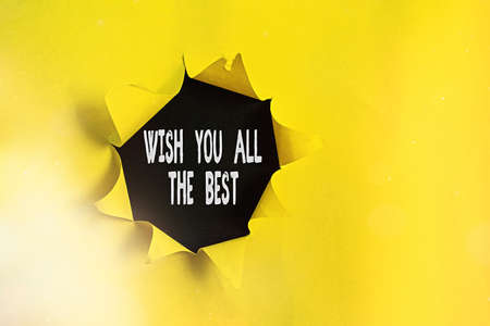 Text sign showing Wish You All The Best. Business photo showcasing Special wishes to have a good fortune or lucky life Rolled ripped torn cardboard placed above a wooden classic table backdrop