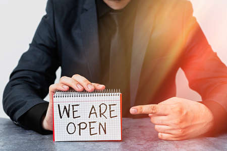 Writing note showing We Are Open. Business concept for no enclosing or confining barrier, accessible on all sides Model displaying different empty color notepad mock-up for writing idea Stock Photo
