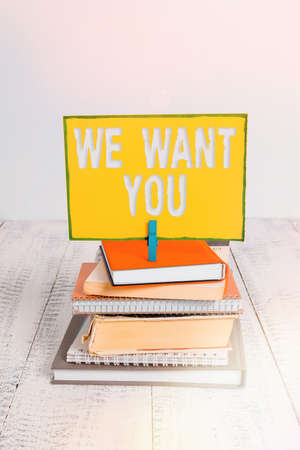 Handwriting text We Want You. Conceptual photo having a desire or would like an individual to do something pile stacked books notebook pin clothespin colored reminder white wooden