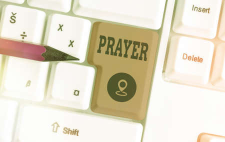 Handwriting text writing Prayer. Conceptual photo solemn request for help or expression of thanks addressed to God Different colored keyboard key with accessories arranged on empty copy space