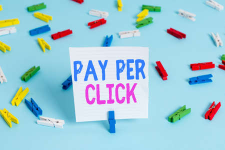 Word writing text Pay Per Click. Business photo showcasing internet marketing in which payment is based on clickthrough Colored clothespin papers empty reminder blue floor background office pin Standard-Bild