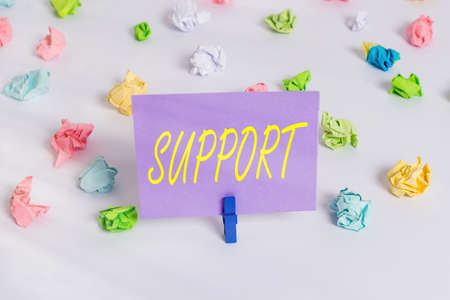 Handwriting text writing Support. Conceptual photo maintain, sustain, uphold all mean to hold up and to preserve Colored crumpled papers empty reminder white floor background clothespin