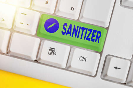 Text sign showing Sanitizer. Business photo showcasing liquid or gel generally used to decrease infectious agents Different colored keyboard key with accessories arranged on empty copy space