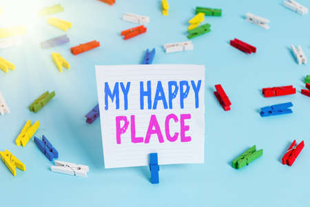 Word writing text My Happy Place. Business photo showcasing something nice has happened or they feel satisfied with life Colored clothespin papers empty reminder blue floor background office pin
