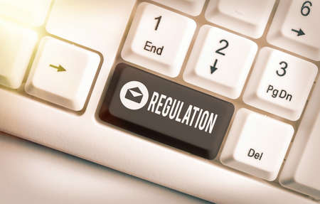 Word writing text Regulation. Business photo showcasing legislation or decision made and maintained by an authority Different colored keyboard key with accessories arranged on empty copy space