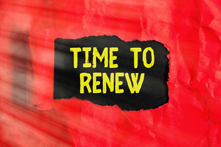 Text sign showing Time To Renew. Business photo text extending the period when something is valid and restorable Rolled ripped torn cardboard placed above a wooden classic table backdrop Banque d'images