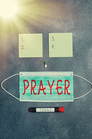 Conceptual hand writing showing Prayer. Concept meaning solemn request for help or expression of thanks addressed to God Set of medical equipment for health condition assessment