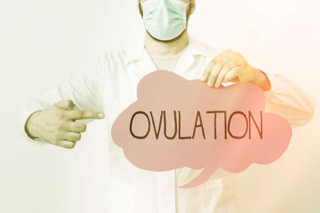 Writing note showing Ovulation. Business concept for the discharge of a mature ovum from the ovary for impregnation Laboratory Technician Featuring Sticker Paper Smartphone