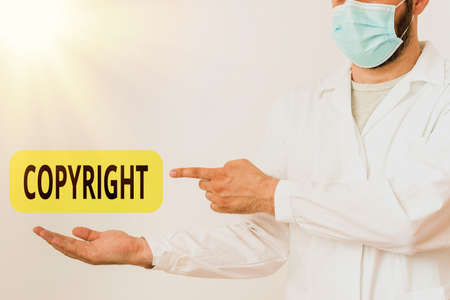 Word writing text Copyright. Business photo showcasing exclusive legal right to reproduce, publish, sell, or distribute Displaying Empty Sticker Paper Accessories Smartphone With Medical Gloves On Stock fotó