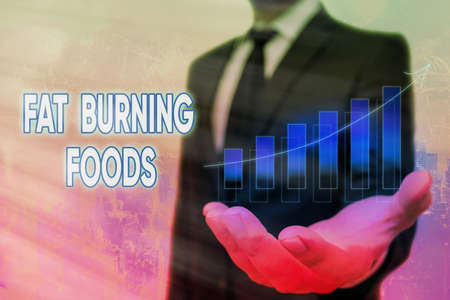 Conceptual hand writing showing Fat Burning Foods. Concept meaning produce fat loss by stimulating metabolism to reduce appetite Arrow symbol going upward showing significant achievement