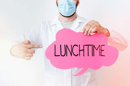 Writing note showing Lunchtime. Business concept for the time at which lunch is usually eaten : NOON, 12 o clock Laboratory Technician Featuring Sticker Paper Smartphone