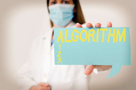 Conceptual hand writing showing Algorithm. Concept meaning procedure for solving a problem or accomplishing tasks etc. Laboratory technician featuring paper accessories smartphone