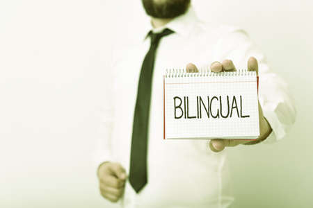 Handwriting text writing Bilingual. Conceptual photo using or able to use two languages especially with equal fluency Model displaying different empty color notepad mock-up for writing idea