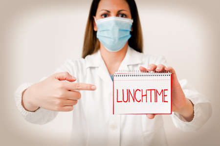 Writing note showing Lunchtime. Business concept for the time at which lunch is usually eaten : NOON, 12 o clock Laboratory technician featuring empty paper accessories smartphone