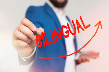 Writing note showing Bilingual. Business concept for using or able to use two languages especially with equal fluency Digital arrowhead curve denoting growth development concept Imagens