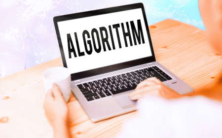 Conceptual hand writing showing Algorithm. Concept meaning procedure for solving a problem or accomplishing tasks etc. Modern gadgets white screen under colorful bokeh background