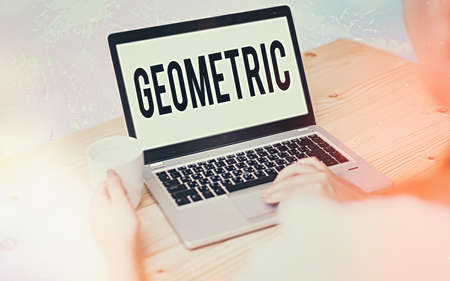 Conceptual hand writing showing Geometric. Concept meaning using straight or curved lines in designs and many more. Modern gadgets white screen under colorful bokeh background