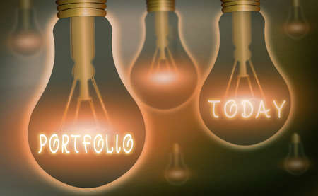 Handwriting text writing Portfolio. Conceptual photo securities held by an investor, paper held by a financial house Realistic colored vintage light bulbs, idea sign solution thinking concept 版權商用圖片