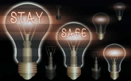 Conceptual hand writing showing Stay Safe. Concept meaning secure from threat of danger, harm or place to keep articles Realistic colored vintage light bulbs, idea sign solution