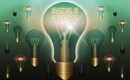Text sign showing Investing In Health Care. Business photo text put money on maintenance or improvement of health Realistic colored vintage light bulbs, idea sign solution thinking concept Banque d'images
