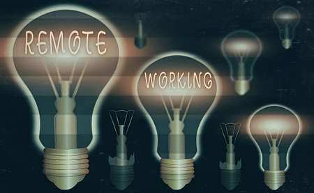 Conceptual hand writing showing Remote Working. Concept meaning style that allows professionals to work outside of an office Realistic colored vintage light bulbs, idea sign solution