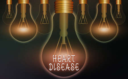 Word writing text Heart Disease. Business photo showcasing A type of disease that affects the heart or blood vessels Realistic colored vintage light bulbs, idea sign solution thinking concept