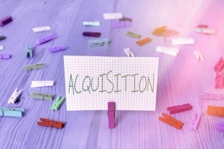 Conceptual hand writing showing Acquisition. Concept meaning asset or object bought or obtained, typically by a library Colored crumpled rectangle shape paper light blue background