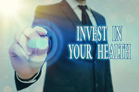 Writing note showing Invest In Your Health. Business concept for put money on maintenance or improvement of your health Graphics padlock for web data information security application system Archivio Fotografico