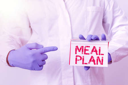 Writing note showing Meal Plan. Business concept for act of taking time to plan any number of meals for the week Laboratory Technician Featuring Sticker Paper Smartphone