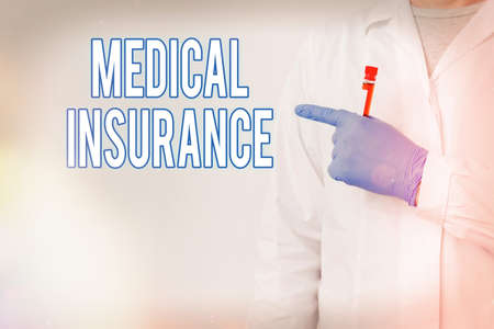 Writing note showing Medical Insurance. Business concept for system of financing the medical expenses of the insured Laboratory Blood Test Sample Shown For Medical Diagnostic