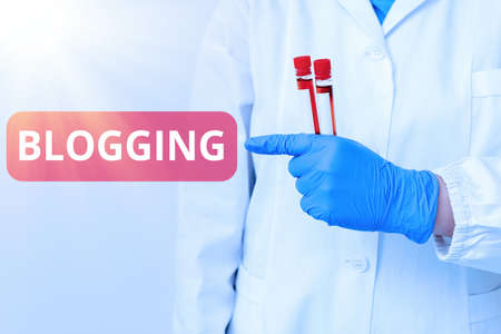 Handwriting text writing Blogging. Conceptual photo write something that contains online an individualal reflections Laboratory blood test sample shown for medical diagnostic analysis result