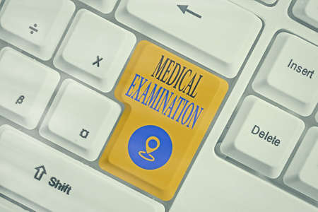 Conceptual hand writing showing Medical Examination. Concept meaning the examination carried out to determine physical fitness Colored keyboard key with accessories arranged on empty copy space