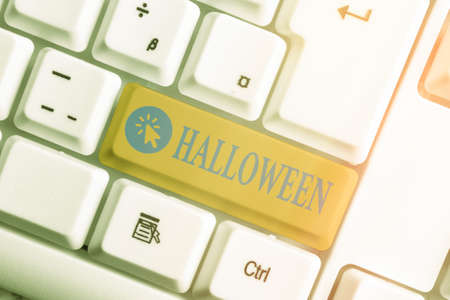 Word writing text Halloween. Business photo showcasing October 31 observed especially with dressing up in disguise Different colored keyboard key with accessories arranged on empty copy space 版權商用圖片