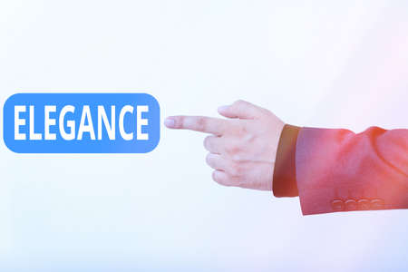 Text sign showing Elegance. Business photo text scientific precision, neatness, and simplicity of something Model with pointing hand finger symbolizing navigation progress growth