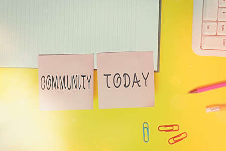 Word writing text Community. Business photo showcasing with a common characteristic or interest living together Flat lay above table with blank papers with copy space for text messages