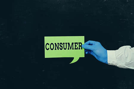 Word writing text Consumer. Business photo showcasing one that utilizes economic goods that are sold by manufacturers Displaying Empty Sticker Paper Accessories Smartphone With Medical Gloves On