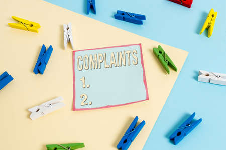 Word writing text Complaints. Business photo showcasing something that is the cause or subject of protest or outcry Colored clothespin paper empty reminder yellow blue floor background office