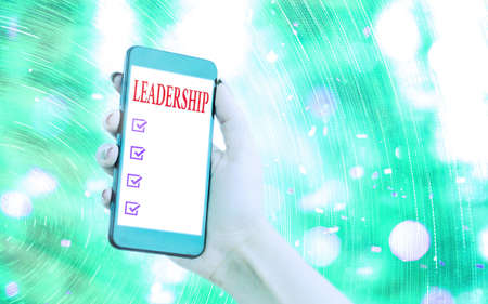 Handwriting text writing Leadership. Conceptual photo ability to guide others without force into direction or decision Modern gadgets with white display screen under colorful bokeh background