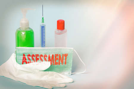 Handwriting text writing Assessment. Conceptual photo action or an instance of making a judgment about something Primary medical precautionary equipments for health care protection
