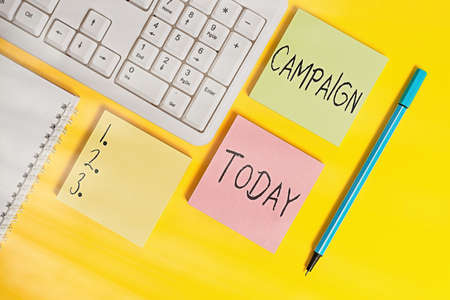 Conceptual hand writing showing Campaign. Concept meaning connected operations designed to bring about a particular result Empty papers with copy space on yellow background table