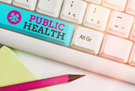 Word writing text Public Health. Business photo showcasing science of protecting and improving the health of a community Different colored keyboard key with accessories arranged on empty copy space