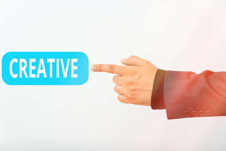 Text sign showing Creative. Business photo text managed to get around legal or conventional limits of laws Model with pointing hand finger symbolizing navigation progress growth