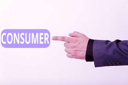 Text sign showing Consumer. Business photo text one that utilizes economic goods that are sold by manufacturers Model with pointing hand finger symbolizing navigation progress growth