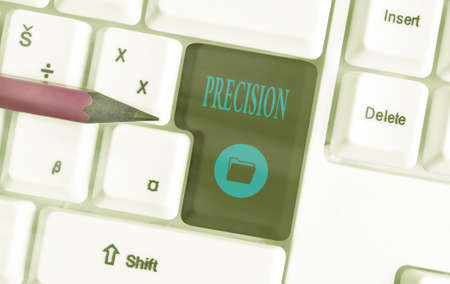 Text sign showing Precision. Business photo showcasing degree of refinement with which an operation is performed Different colored keyboard key with accessories arranged on empty copy space