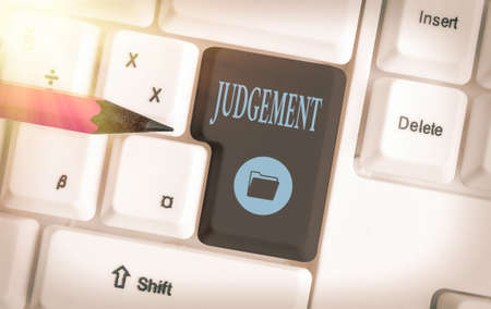 Text sign showing Judgement. Business photo showcasing process of forming an evaluation by discerning and comparing Different colored keyboard key with accessories arranged on empty copy space Imagens