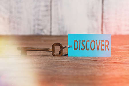 Writing note showing Discover. Business concept for obtain sight or knowledge of for the first time in your entire life Paper accessories with smartphone arranged on different background Stock Photo