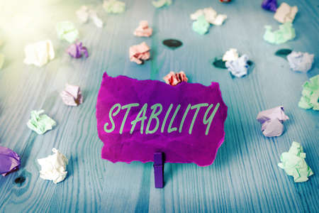 Text sign showing Stability. Business photo text property of a body that causes it when disturbed from equilibrium Colored crumpled rectangle shaped reminder paper light blue background